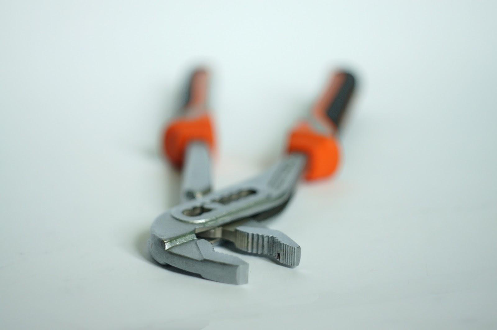 Orange-handled pincers.