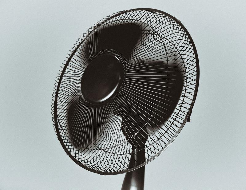 black electric standing fan.